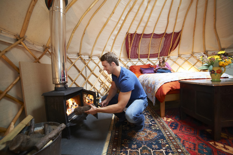 Glamping - A Couple Enjoying Luxary Yurt Camping